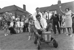 Graham Hill and Damon pushing Jim Clark around on a toy tractor. Different era!