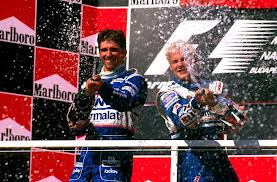Damon and Jacques celebrating his luckiest win ever at Hungary, 1997