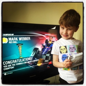 The ecstatic 5 year old having steered Mark Webber to title victory!