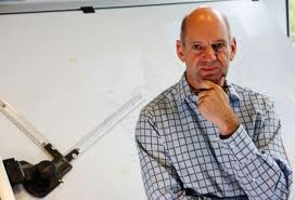 Adrian Newey in relaxed pose.